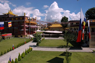 Tharlam Monastery of Tibetan Buddhism ready for the crowds, with tents strung and Buddhist flags, with the puffy Himalayan clouds high above Boudha in the Kathmandu Valley, Nepal
