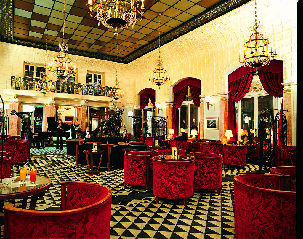 Art deco Interior Design with red seats and cool ceiling and floor at Lutetia Bar at the Hotel Lutetia Paris, Rive Gauche, France