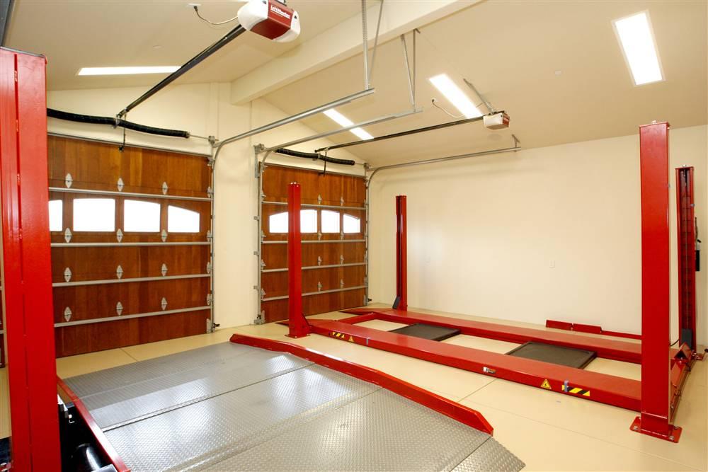 World 39 s most beautiful garages exotics insane garage for Beautiful garage interiors