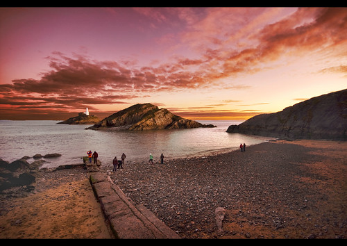 sunset sea lighthouse beach wales sand raw scape newyearsday 2010 themumbles thepinnaclehof kanchenjungachallengewinner tphofweek26