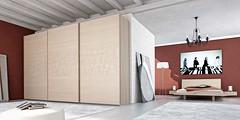 """Mazzali: """" BE FREE """" slidingdoors wardrobe.  Bedroom and living area"""