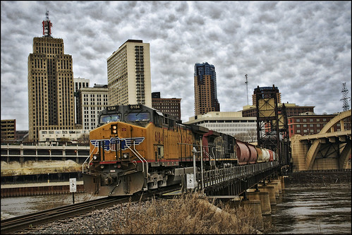 city railroad bridge urban fall water minnesota architecture clouds train buildings river mississippi downtown gloomy grunge tracks stpaul railway overcast transportation unionpacific twincities mn freight tressel robertstreetbridge verticallift