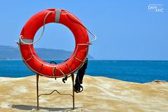 vehicle(0.0), sailing(0.0), parasailing(0.0), personal flotation device(0.0), windsports(0.0), wind(0.0), toy(0.0), sea(1.0), lifebuoy(1.0),