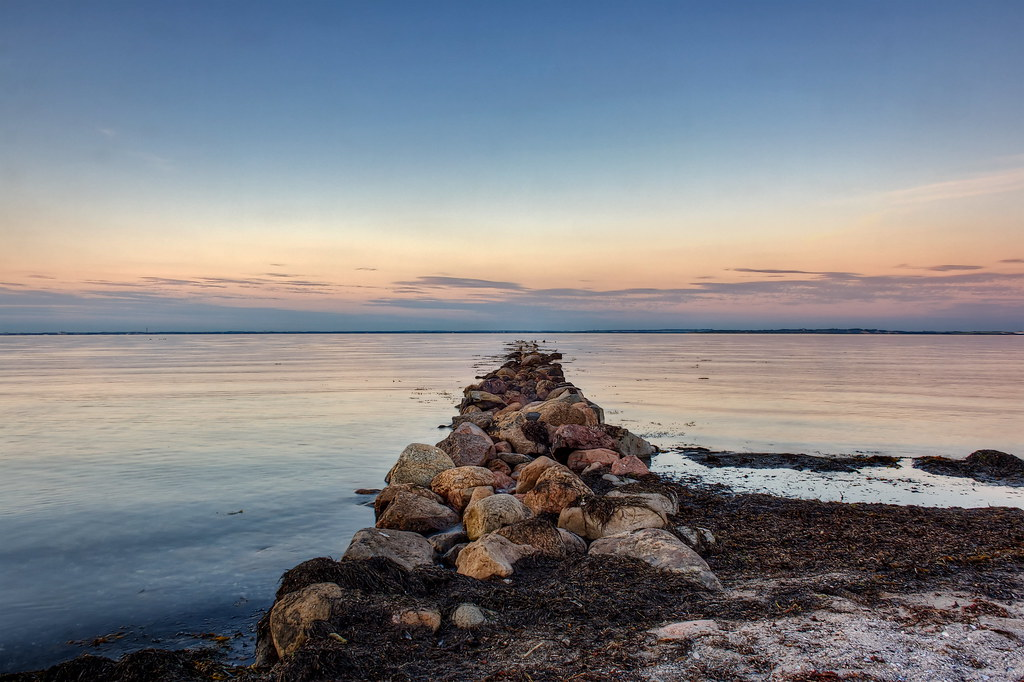 The oldest known name of the strait is urasu[n]ti which appears on a runestone from about 950 and it was locally known as Oresund in the 13th century. The strait is today called Øresund in Danish and Öresund in Swedish, informally Sundet in both languages. The prefix ør(e) means gravel beach and a sund is a sound or narrow seaway.  Political control of Øresund has been an important issue in Danish and Swedish history. Denmark maintained military control with the coastal fortress of Kronborg at Elsinore on the west side and Kärnan at Helsingborg on the east, until the eastern shore was ceded to Sweden in 1658. Both fortresses are located where the strait is just 4 kilometers wide.   In 1429 King Eric of Pomerania introduced the Sound Dues which remained in effect for more than four centuries, until 1857. Transitory dues on the use of waterways, roads, bridges and crossings were then an accepted way of taxing which could constitute a great part of a state's income. The Sound Dues remained the most important source of income for the Danish Crown for several centuries, thus making Danish kings relatively independent of Denmark's Privy Council and aristocracy.  source: wikipedia.org  All Rights Reserved © René Eriksen. Please do not use my pictures outside the Flickr, without my permission.