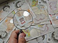 Magnifier glass and money