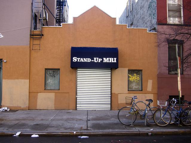 Storefront metal gate stand up mri east village flickr photo