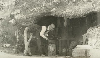 Cooking in a rock cave in Mount Mulligan, August 1912