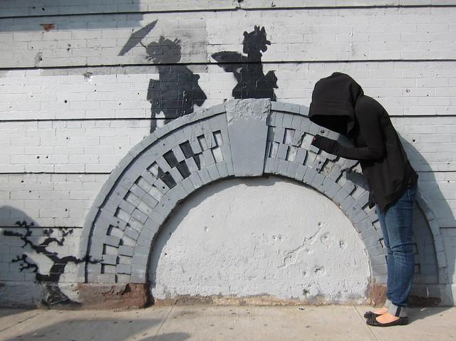 Banksy in Williamsburg, Silouettes on a Bridge: Art fan dressed as Banksy