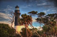 Early warm sun rays hit the lighthouse