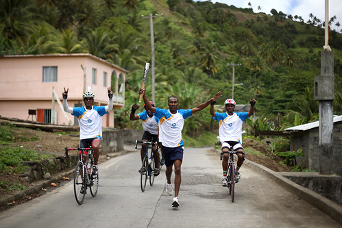 Marathon runner Dwight Baptiste relays the Queen's Baton with the St. Vincent Cyclists in Kingstown, St. Vincent and the Grenadines on Friday 14 March 2014. St. Vincent and the Grenadines is nation 46 of 70 Commonwealth nations and territories to be visit