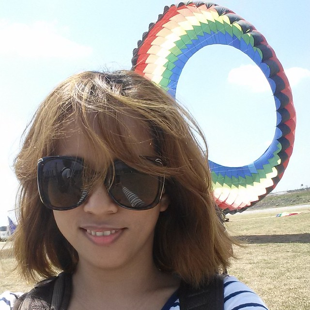 wind blown hair Giant Kite flying at Sandbox Adventure Alviera