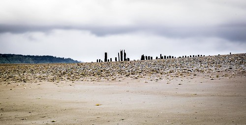 picnicpoint edmonds washington unitedstates us beach landscape pilings sand stormclouds longexposure slowshutterspeed trinterphotos