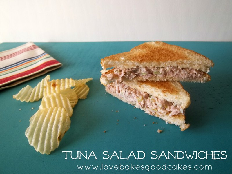 Tuna Salad Sandwich cut in half with potato chips.