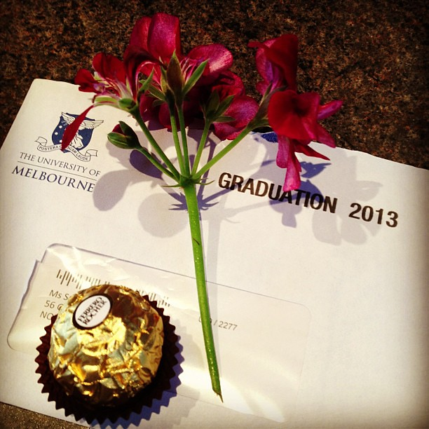 Came home last night to find my graduation details had arrived. The mister left it  on the kitchen bench for me to find, with little flower and chocolate.  He's not bad sometimes.