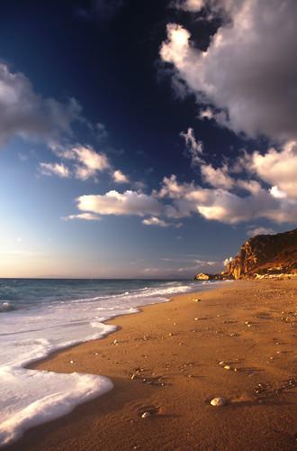 sunset sea sky mountain color beach clouds sand rocks waves shadows pentax stones horizon greece hdr highdynamicrange cpl ioniansea pentaxkx ionio lefkada kathisma tonemapping circularpolarizingfilter kostasharilogis