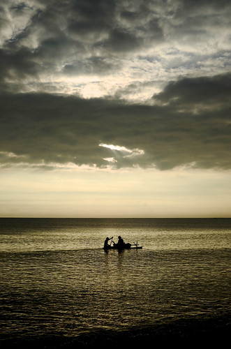 people fish water silhouette clouds sunrise fishing horizon floating canoe float outrigger vanuatu pacificislands eastasiaandpacific