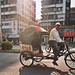 Rickshaw driver in the streets of Shantou, China by Merton Wilton