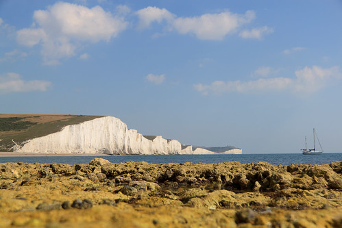 Sprogz posted a photo:	Spent today wandering along the Sussex coastline.The Seven Sisters are a series of chalk cliffs by the English Channel. They form part of the South Downs in East Sussex, between the towns of Seaford and Eastbourne in southern England.