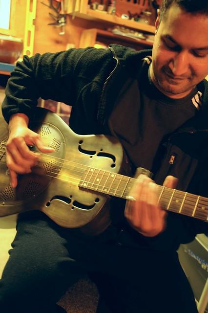 Photo:Abi playing his Dean Heirloom Resonator dobro guitar with a slide and obvious enjoyment! Tacoma, Washington, USA By Wonderlane