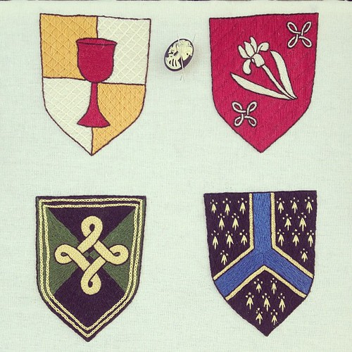 All four finished baronial devices.