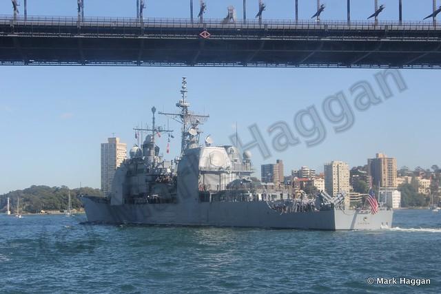 The USS Chosin sails under Sydney Harbour Bridge during the International Fleet Review, Sydney, Oct 2013