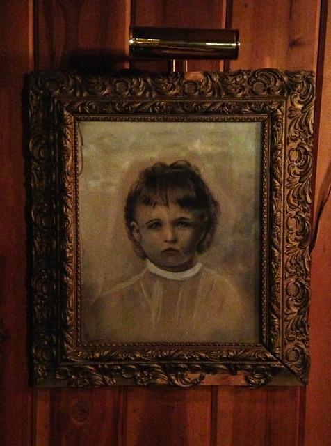 Maziel Moriarity portrait hanging on a wall in The Iron Door Restaurant.