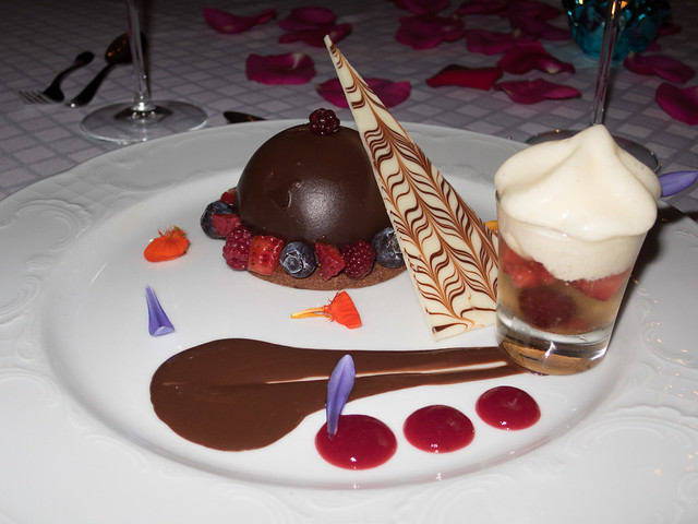 Semisphere of chocolate mousse with berries, and a shot of red fruit in Cosecha Tardía (wine) topped with mint foam