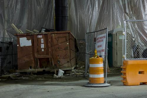 chrispackart canon canont2i construction dumpster site dumpsters portajohn fence city cityscape landscape traffic cone trash osu nighttime night street