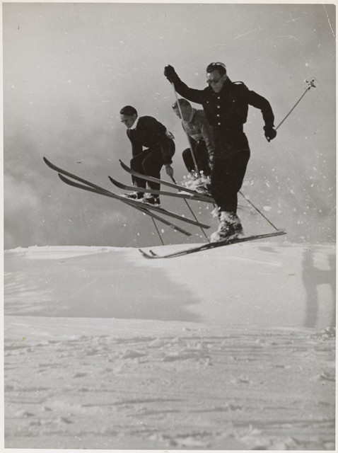 Three men ski jumping, Snowy Mountains Region, New South Wales, ca. 1942.