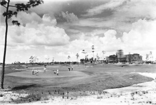 Golfers at the Miami Biltmore Golf Club during hotel construction