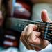 Playing guitar by Henrik Godsk Hansen