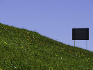 A sign on a hill, by the Tasman Highway