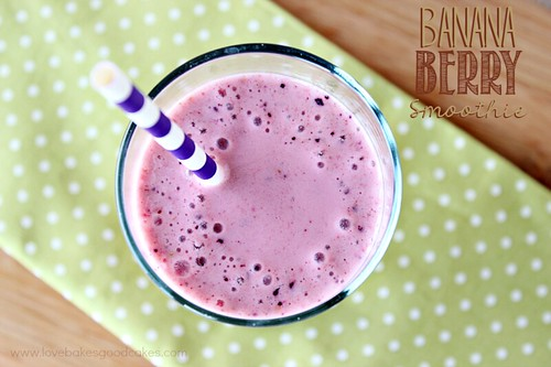Banana Berry Smoothie in glass with straw top view.
