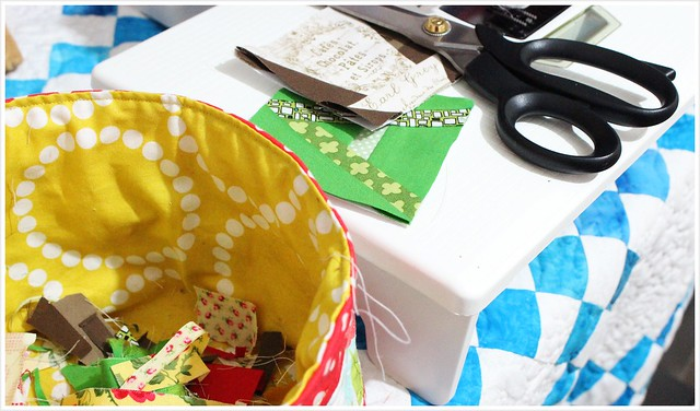 Using scissor to cut away excess in paper foundation and scrap basket keep clean
