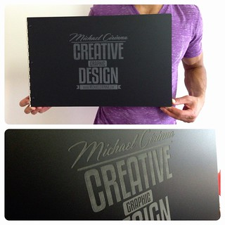 Custom matte black acrylic portfolio book with graphic design portfolio book