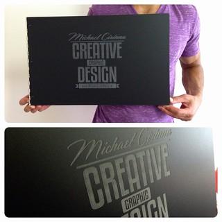 Custom matte black acrylic portfolio book with graphic design portfolio book