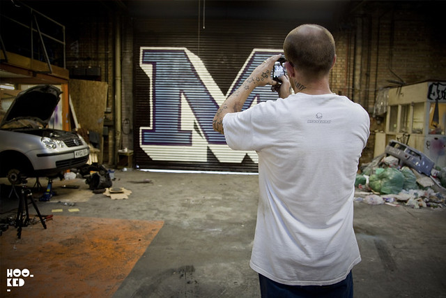 London Street Artist Ben Eine at work on a typographic Shutter Mural