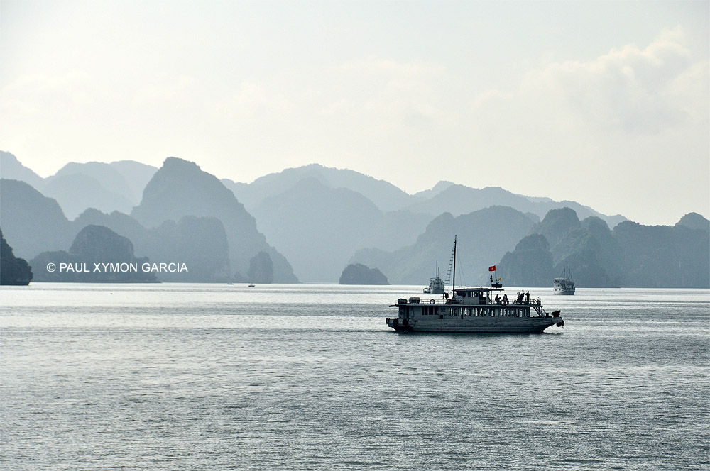 A white junk boat in Halong Bay