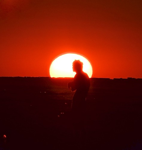 beach sunset dance oakisland man settingsun ocean