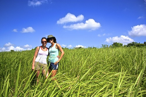 Lina and Dina pose in a grassy field in our hike just outside of Ubud