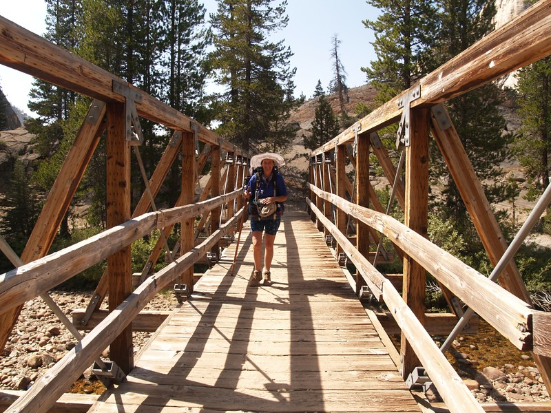 Crossing the wooden bridge over Conness Creek into Glen Aulin High Sierra Camp