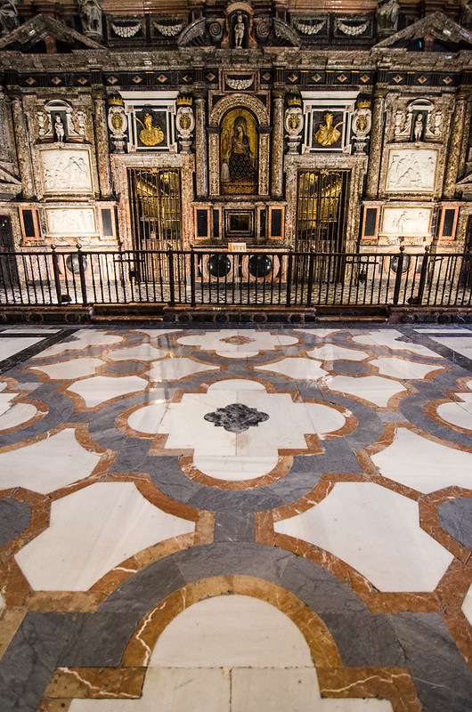 Dramatic baroque tiles cover the floor of the Seville Cathedral in Spain.