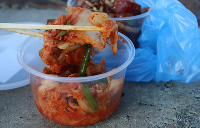 Eating a tub of kimchi in Hawaii