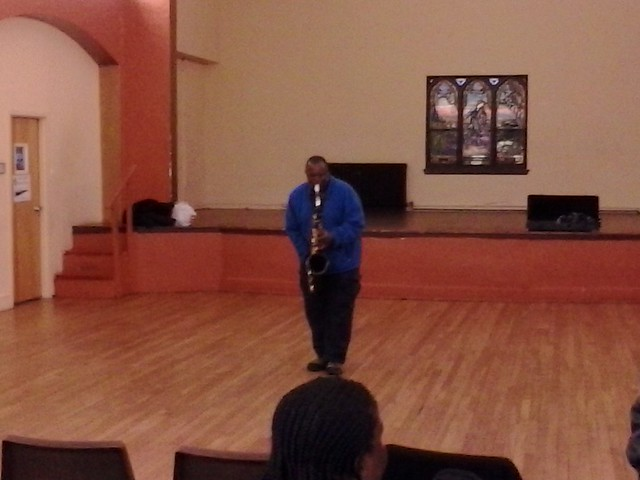 Saxophonist plays at Black History celebration at Organization of United People