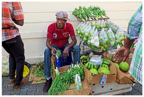 sales sidewalk produce farmersmarket stgeorge grenada caribbean island candid canon5d streetphotography men