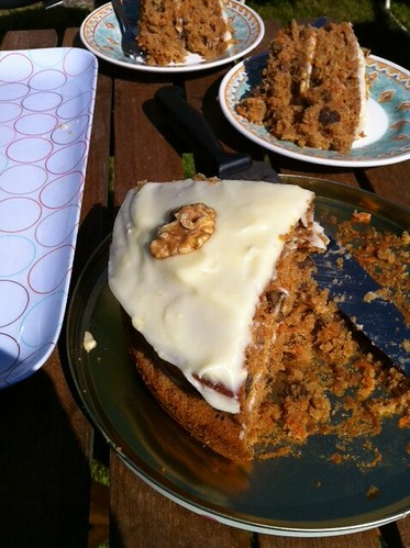 Eating some carrot, sultana and walnut cake. by benparkuk