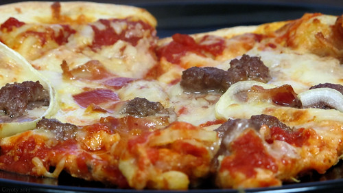 Sausage, onion, and bacon pizza