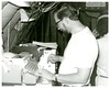 January 1, 1974 - 12:00am - David Bergen at console of dropwindsonde recording system. (JKUE-000-000-000-023)