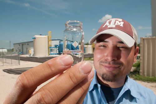 Anthony Arredondo takes a water sample at the Freer Water Control and Improvement District Arsenic Removal System Site in Freer, TX on Tuesday, June 18, 2013. USDA Photo by Lance Cheung.