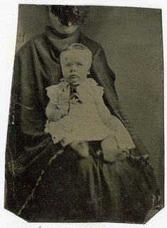 Tintype of Wide Eyed Baby and Hidden Mother with Scratched Out Face